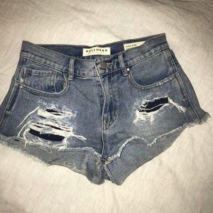 High-rise demon shorts, with distressed detail.